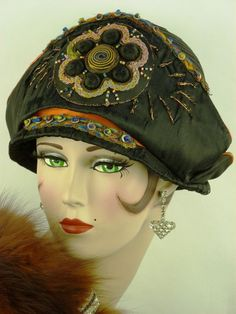 This beautiful original cloche is constructed in black silk with a high turn back pointed brim, the body of the hat is in black sisal. A beautiful embroidered beaded and braid work applique sits to the front with a gold thread embroidered sun burst. | eBay!