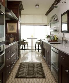 Galley kitchen, floor tile.  Looking at how to use dark cabinets