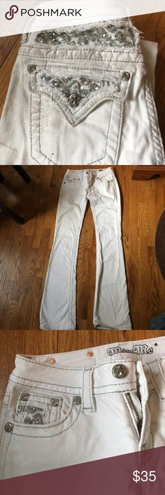 """White miss me bling boot cut jeans White miss me bling boot cut jeans. Size 26. They don't say an inseam.  I am 5'4"""" and these drag the ground in my boots.  These are excellent condition....but I showed cows in them so there are stains at the bottoms and at the back pockets.  Not a problem if you show but not want you want if you just want cute jeans Miss Me Jeans Boot Cut"""