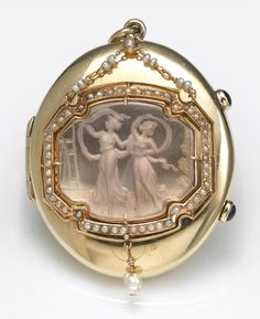 A rock crystal quartz intaglio, seed pearl and fourteen karat gold locket, circa 1910  weighing approximately: 44.5 grams; dimensions: 2 1/4 x 1 3/4in.