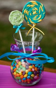"Graduation Centerpiece Ideas | Some fabric flower ""lollipops"" I made using knit fabrics then I ..."