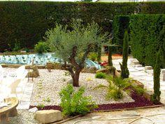 Parterre avec cailloux am nagement d 39 un petit jardin for Massif avec cailloux