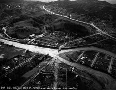 Aerial view of the Lankershim Bridge in Universal City, that was destroyed by flood waters from the massive storm system that struck in March of 1938. People gathered at the ends of the bridge to watch the waters rage past the now destroyed bridge. After this storm, due to public outcry, the Army Corps of Engineers began the 20 year project to create the permanent concrete channel which still contains most of the of riverbed today. (Water and Power Associates)