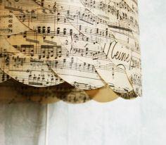 Sheet music covered lamp shade. cut into circles.