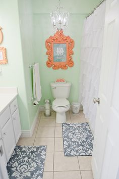 Mint & Coral Bathroom.  Describes how projects were made and lists where to buy everything. I love it!!