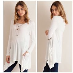 Last 2 Items •Slouchy Cape ivory tunic Ivory tunic nwot with pockets size small medium  and large . Spandex and rayon fabric nwot sizes S M L . Super soft and wonderful fit made in USA please comment for a personal listing . Vivacouture Sweaters