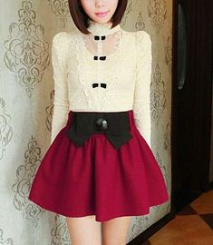 The red skirt with the white and black shirt are very nice together