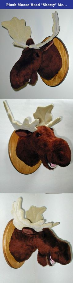 "Plush Moose Head ""Shorty"" Medium Plaque Mount. Shorty's plush fur is a soft short pile. He has deep fuzzy nostrils, and a fixed lower jaw complete with teeth and tongue. His eyes and his antlers are almost too big for his head. But if you want a tough almost comical looking moose, he's perfect! PRODUCT SPECS: Ready to hang. Shorty's depth is 13"" from nose to wall. Adjustable antler span is 16"". Girth at shoulder is 23"". Plaque size is 9"" x 12""."