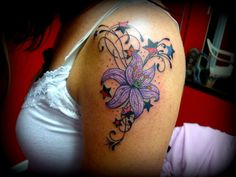 Stars And Purple Lily Tattoo On Left Shoulder : Lily Tattoos Bug Tattoo, Epic Tattoo, Tattoo Sun, Star Tattoos, Girl Tattoos, Tatoos, Aster Flower Tattoos, Lilies Tattoo, Crohns Tattoo