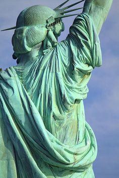 statue of liberty,statue,liberty,new york,new york city,back of statue ,behind liberty,new york,new york city, manhattan,pride,dignity, importance, merit,proud