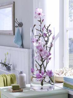 elegant simplicity: a flowering branch in a cylinder vase