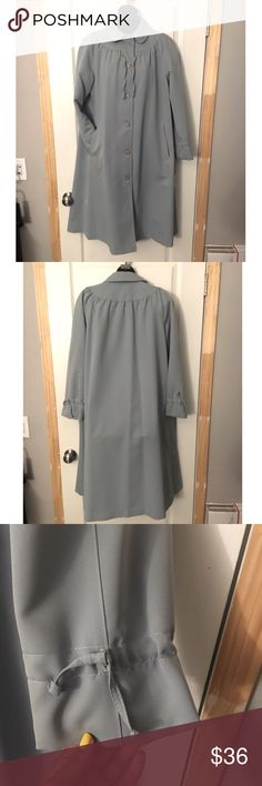 Vintage raincoat ⛈ Feminine styling and a grayish baby blue in color  Drawstring collar and wrists  All buttons account for, including the spare button!  Appears to be in perfect condition Forcaster of Boston Jackets & Coats