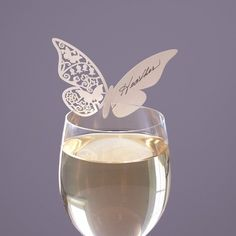 Exclusively Weddings | Butterfly Place Cards-cute idea, can multi-task as drink marker or take home bookmark.