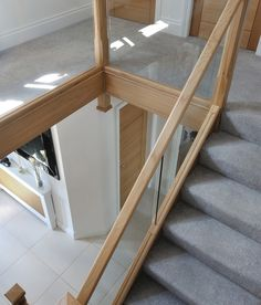 We used a modern mix of glass and natural oak with carpeted treads that sweep around the first-floor landing. This allowed us to create a contemporary style staircase with half landing. To add to the modern finish, glass is inset into the wooden staircase Concrete Staircase, Wooden Staircases, Stairways, Glass Stairs Design, Staircase Design, Home Design Store, House Design, Staircase Frames, Staircase Ideas