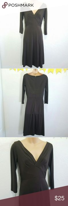 """Green Ann Taylor Loft Career Dress Wrap Waist Sz 2 -Excellent used condition- no rips, stains, or tears -No pockets -Flattering wrap fit Please use measurements for best fit, all measurements are taken laying flat: -Bust 16"""" -Length shoulder to hem 43""""  -50% Rayon -50% Polyester -Dark muted green (colors' appearance may vary on screen)  Questions? Just ask! Bundle to save!  Offers welcome  Happy Poshing! LOFT Dresses Long Sleeve"""