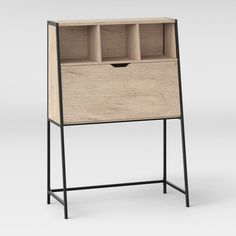 For some true mid-century modern style, add the Loring Secretary Desk from Project 62™ to your living space. The door on the large compartment opens up and can be used as a writing desk. Use the cubbies on top to organize documents and bills and keep track of incoming and outgoing mail.<br><br>1962 was a big year. Modernist design hit its peak and moved into homes across the country. And in Minnesota, Target was born - with the revolutionary idea to celebrate design for a...