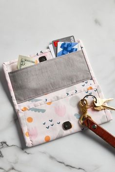 This DIY wallet features multiple pockets to keep your important cards, cash, and loose change organized. Customize your handmade wallet with your favorite patterned fabric for a card case you'll love using every day. This fun sewing project comes together in an afternoon and requires just a few easy-to-master techniques. #freesewingpattern #beginnersewingprojects #freesewingpatterns #bhg Bag Patterns To Sew, Sewing Patterns Free, Free Sewing, Fabric Wallet, Diy Wallet, Handmade Wallets, Handmade Bags, Creative Crafts, Fun Crafts