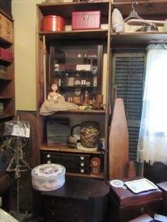 Vintage sewing notions , Coats and Clark Thread storage , orange measuregraph ,Boye needle cabinet  ,and wire dress form