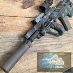 Suppressed Steyr AUGLoading that magazine is a pain! Get your Magazine speedloader today! http://www.amazon.com/shops/raeind
