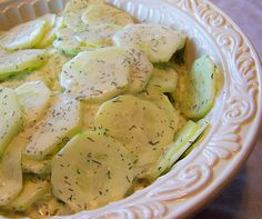 Creamy Dill Cucumbers: 3 cucumbers, thinly sliced; ½ C. onion, thinly sliced; ¼ C. white vinegar; ¼ C. sugar; ¼ tsp salt; 1 C. mayonnaise, (not Miracle Whip); 1 tbsp dried dill. Combine vinegar, sugar & salt. Add mayo, stir til smooth. Stir in dill. Pour over sliced cucumbers & onion. Let sit in fridge a few minutes to allow flavors to meld.