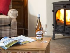 Pour a glass of wine and snuggle up into the soft fireside sofas at Iona Cottage in the Eden Valley.