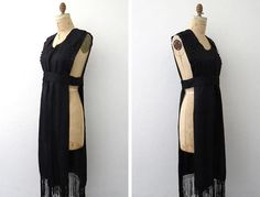 Amazing Edwardian (specifically late 1910s) pinafore dress with fringe along the hem. Dress is made with a beautiful Edwardian black fabric and