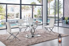 Not only making a dining room looks modern, but a glass dining table can also make the room looks elegant. These modern glass dining table design are great! Glass Dining Table Designs, Glass Dining Table Set, Modern Dining Room Tables, Dining Room Sets, Dining Table Chairs, Round Dining Table, Dining Furniture, Dining Area, Dinning Set