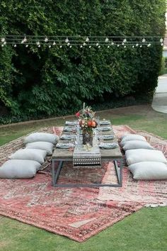 Host an outdoor dinner party, starring a pair of jam-tone rugs as your guests of honor.