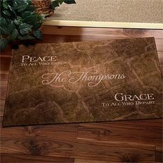 """Personalized Family Name Welcome Mat - Peaceful Welcome . $22.95. Give """"Peace To All Who Enter"""" and """"Grace To All Who Depart"""" with our exclusive Peaceful Welcome Custom Doormat.This elegant piece of art creatively displays your family name or first name(s) within the center of the design, amidst a neutral, textured backdrop."""