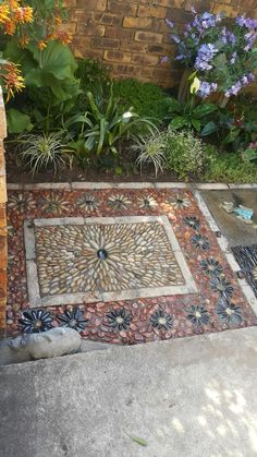 Pebble mosaics by Designer SP Botha owner of Designer Gardens Landscaping www.designergardenlandscaping.co.za