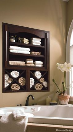 Between the studs, in wall storage - Would be awesome on the bare wall above the tub in our master bath.