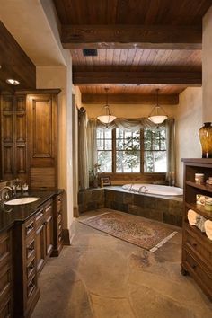 I'd love this bathroom, but with darker wood...and a fireplace by kelly