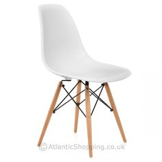 With a trendy retro vibe, the Eames Style Wooden Chair & Satin White is always a winner. White Eames Chair, White Wooden Chairs, White Armchair, Kitchen Chairs, Dining Chairs, Dining Table, Blue Striped Curtains, Conservatory Decor, Decoration Gris