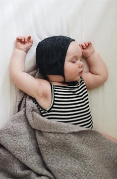 Naptime! Cutie little one in cozy black and white striped tank onesie by Goat Milk with perfect little bonnet from Briar Handmade for your little french baby. Perfect shower gift for stylish newborns