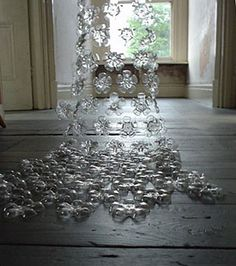 Made from the bottom of plastic bottles!  Amazing