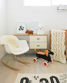 This bright room is inspired by a minimal scandinavian style and a perfect place for adults and kids. All surfaces are easy to clean. The rocking chair is a clean but comfortable interior solution. Wooden elements like a small white cupboard enrich the room. Looking for more inspiration? Check out our Blog!