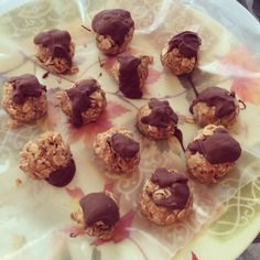 No bake Protein balls. Easy enough for kids to make.   -rolled oats -raw organic honey -fresh pressed honey roasted peanut butter  -chia seeds -chocolate   Mix all ingredients in a bowl until well mixed. Roll into balls and let cool in freezer for 10 minutes.  Melt chocolate and drizzle over protein balls. Enjoy!
