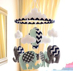 Elephant Hot air Balloon Nursery Mobile - MADE TO ORDER by FlossyTots on Etsy https://www.etsy.com/listing/214391983/elephant-hot-air-balloon-nursery-mobile
