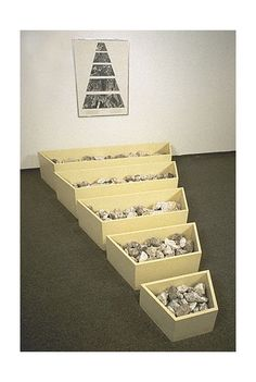 Robert Smithson: A NONSITE (FRANKLIN, NEW JERSEY), 1968. Bins installed: 16 1/2 x 82 1/4 x 103 in. (41.9 x 208.9 x 261.6 cm); Framed: 40 3/4 x 30 3/4 x 1 in. (103.5 x 78.1 x 2.5 cm); Sheet: 39 7/8 x 28 7/8 in. (101.3 x 75.9 cm) Medium: Painted wooden bins, limestone, gelatin silver prints and typescript on paper with graphite and transfer letters, mounted on mit board.