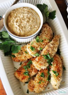 Oven-friend crispy chicken dippers with pesto-yogurt sauce. Fast, healthy and delicious!
