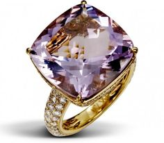 The 15 carat cushion shaped amethyst is intricately detailed with 178 round white diamonds which give off a beautiful violet glow upon the finger.
