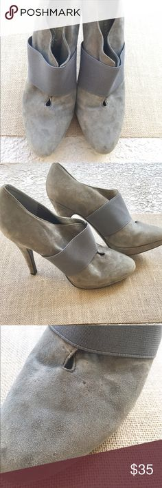 """{Jessica Simpson} Grey Suede slip on bootie Fun for Date Night! Beautiful, supple neutral grey suede slip on bootie with elastic detail. Sexy and sassy with 4.5"""" stiletto heel. Slight platform makes them easy to walk in- worn 3times and of course I hit the stair with the heel of the shoe- picture shows slight rub on heel and light spots on toe. Hardly noticeable when worn. Jessica Simpson Shoes Ankle Boots & Booties"""
