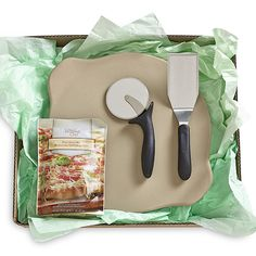 Must-Have Gift for Pizza Night - The Pampered Chef®  Includes Pizza Crust Mix, Large Round Stone with Handles, Pizza Cutter and Large Serving Spatula.