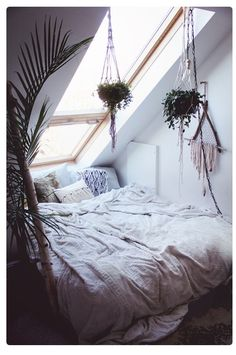 Macrame plant hangers and bed nook under attic window. Sweet dreams under the stars.