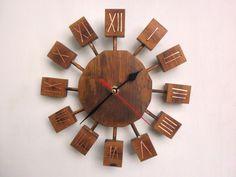 "Wooden sunburst clock by ThirdCloudToTheLeft. 10"" wide."
