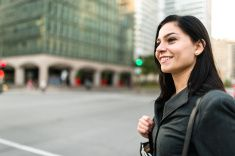 successful business woman walking on the city stock photo