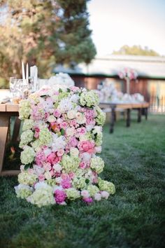 a stunning flower blanket centerpiece |  Photography by abiqphtoography.com |   Read more - http://www.stylemepretty.com/2013/08/05/oakland-wedding-from-abi-q-photography/