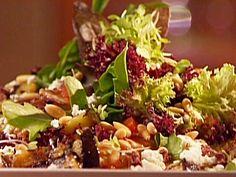 Recipe courtesy of Emeril Lagasse: Mediterranean Chicken Salad Directions  In a medium skillet, combine the wine, onion, lemon, bay leaf, peppercorns, salt, and...