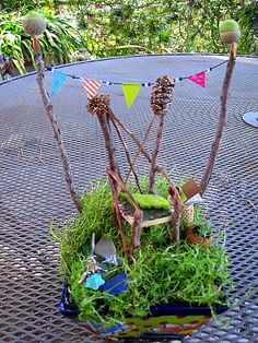 Fairy Garden in Mexican painted pot with live Irish moss, twig chair, woven seat, felt leaf cushion, sea glass, cork table, washi tape garland, acorn and felt finials, live succulent in acorn pot, acorn goblet for nectar, music book with bark cover, bead angel hanging ornament