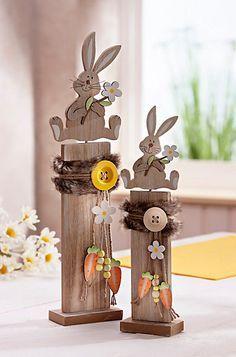 """2 Holz Deko Sockel Säulen Häschen Osterhase Hase Hasen Frühling Ostern Fenster - EUR 16,90. """"Dekosockel """"Häschen"""", 2er-Set""""Trend-Deko im Naturlook Aus Holz, mit originellen Hasenfiguren Liebevoll gestaltet und verziert Set mit 2 Größen: Höhe 48 + 36 cm Nicht nur für die Osterzeit … Diese zwei Hasen haben immer Saison und wollen hoch hinaus. Darum haben sie sich auf ein Podest gestellt, so kann man sie gebührend bewundern. Denn sie sind so liebevoll und detailliert gearbeitet, dass m..."""